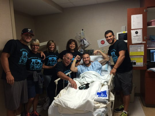 Brett Epps surrounded by family during a hospital stay.