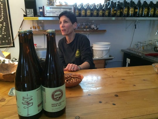 Paradox Brewery co-owner Joan Mrocka tends the bar