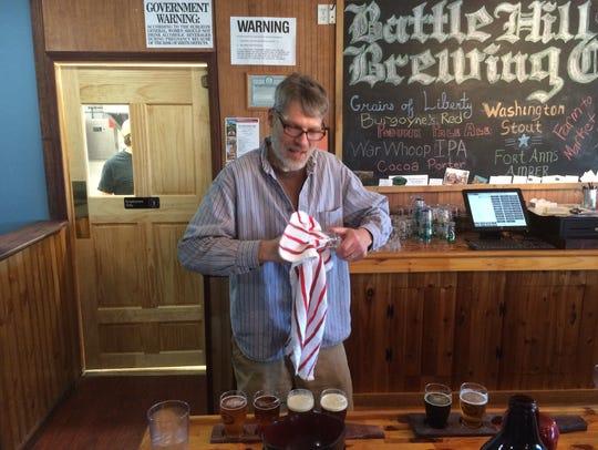 Co-owner Davis Wornall works Saturday at Battle Hill