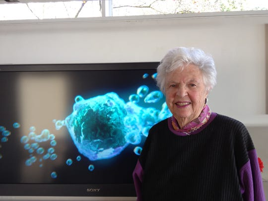 "Alice Weston with her photography, ""Crystal Clues to the Sublime."""