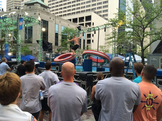 A crew member shows IMPD and IFD competitors how to do one of the obstacles Tuesday.