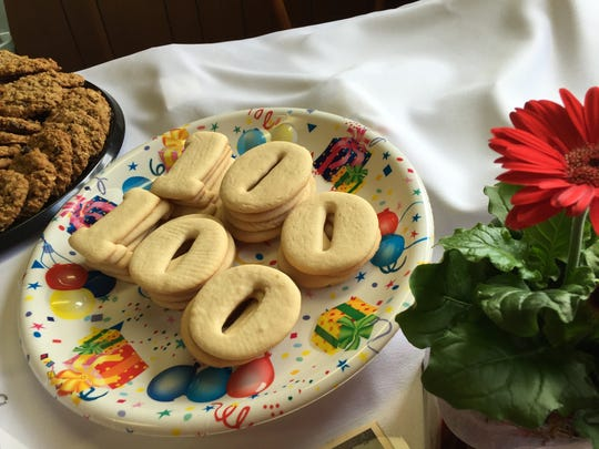 A plate of cookies spell out 100, celebrating Dick Taylor's 100th birthday.