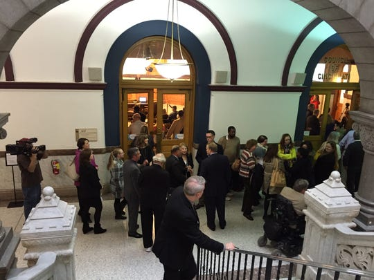 The line leading into Council Chambers at City Hall for a public hearing of the city's Historic Conservation Board.