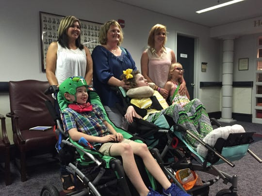 From left to right: Meggan Jackson and her son Caden; Kari Forsyth and her daughter Chesney and Brittany Townsend and her daughter Kenna, who all traveled to the Alabama State House on April 27, 2016 to witness final legislative approval of Leni's Law. The bill, sponsored by Rep. Mike Ball, R-Huntsville, expands access to cannabidiol (CBD), a marijuana derivative that could help control seizures and other debilitating conditions.