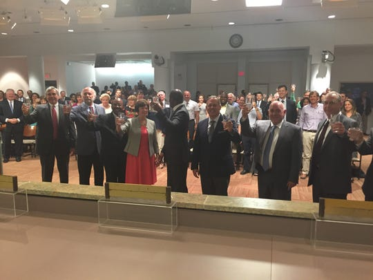 City officials raise a toast at Wednesday night's meeting in recognition of the city's water being named best tasting in Florida for the second straight year.