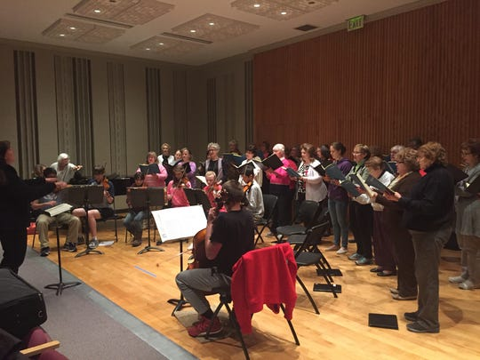 Pro Musica rehearses alongside the Youth Symphony April 26, in preparation for their spring concert.