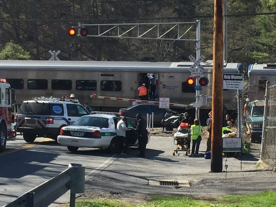 Emergency personnel on scene at the intersection of Green Lane and Metro-North's Harlem Line tracks in Bedford, where a northbound train struck a car.