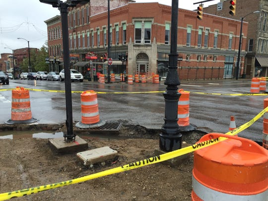 Sidewalks are being removed at numerous downtown corners as a downtown repaving project begins.