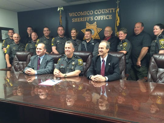 Members of the Wicomico County Sheriff's Office pose for a picture after a collective agreement is signed Thusday April 29, 2016.