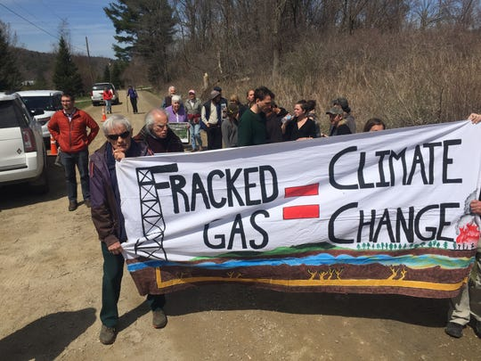 A group protests the extension of a Vermont Gas natural gas pipeline on April 29, 2016, near the location in Monkton where another protester has suspended herself in a tree for the past two weeks.