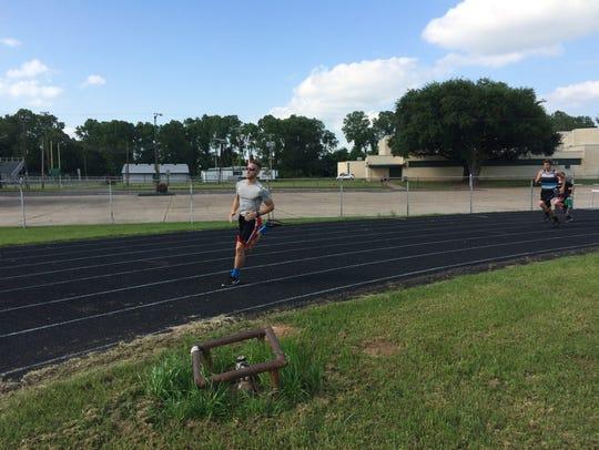 Senior Austin Helms leads the Shreveport Force track