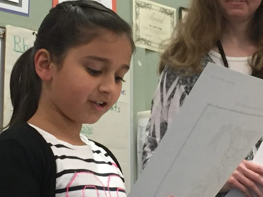 Englewood second-grader Anupreet Powar reads her winning SJ Kids answer at an April 27, 2016, presentation from Nancy Harrington on the Statesman Journal staff.