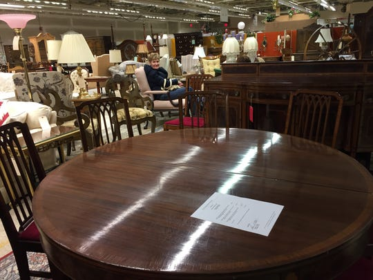 This Hepplewhite dining set circa 1910 is at the Ronald McDonald House Charities sale.