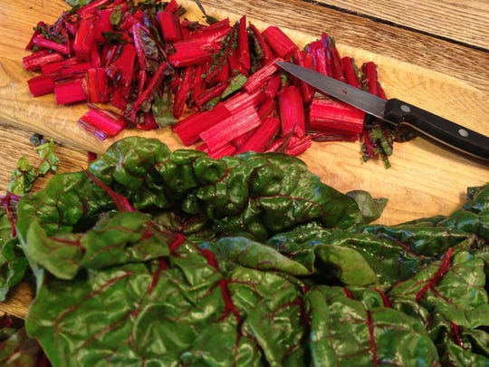 The cooking of chard begins with cutting the green leaves away from the thick stems. American cooks sometimes discard the stems, but French cooks turn them into a delicious gratin.