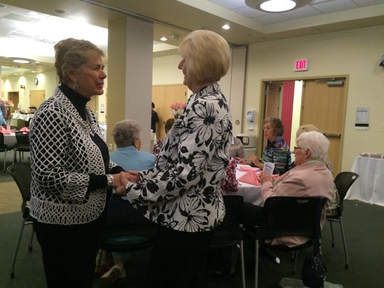 Faye Holloway, right, visits with members of the Junior Auxiliary Board May 4, 2016.