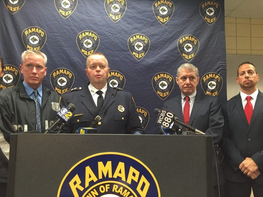 Ramapo Police Chief Brad Weidel with District Attorney Thomas Zugibe and Senior Assistant District Attorney Richard Kennisin Moran (Weidel's  left) Ramapo Detective Robert Fitzgerald on Weidel's right.