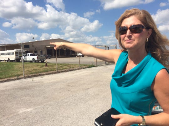 Cheryl Eby Gutjahr, broker at Rawls Real Estate, points to a warehouse at Weekley Brothers Industrial Park in Clewiston.