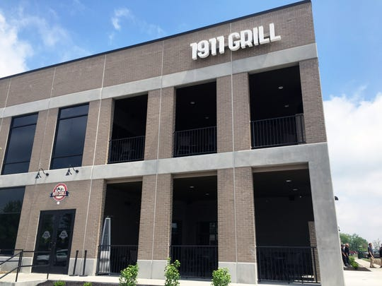 A two-level shaded patio at the new 1911 Grill in Speedway.