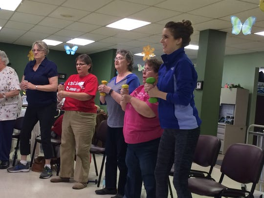 UW-Extension Family Living Educator Tenley Hitz directs a Tuesday morning StrongWomen workout.