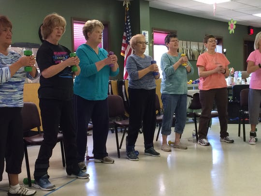 Door County women enrolled in the StrongWomen class held at the Door County Senior Center start their strength training course.