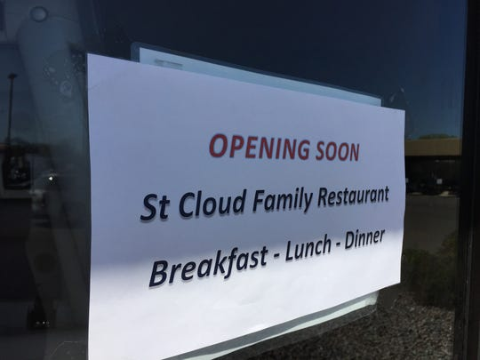 A sign taped to the outside door of Old Country Buffet says St. Cloud Family Restaurant is coming soon to Midtown Square.