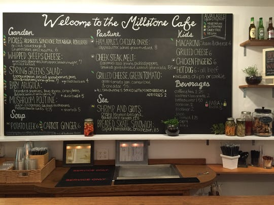 The board at the Millstone Cafe lists its new menu, which will feature locally sourced items.