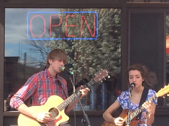 Folk duo Cricket Blue performs Saturday outside McKee's Pub and Grill during the Waking Windows festival in Winooski.
