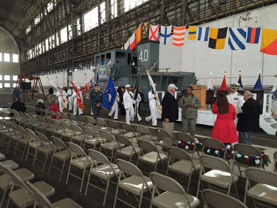 A Navy honor guard rehearses inside historic Hangar No. 1 at Joint Base McGuire-Dix-Lakehurst on Friday evening, where the annual memorial service commemorating the Hindenburg disaster was moved due to rain and wind.