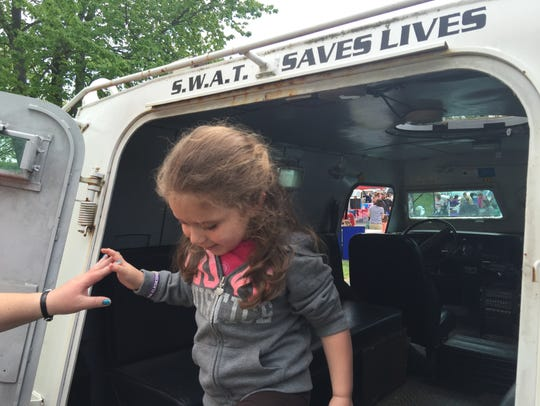 Dylynn Thompson, 4, of Swoope gets a helping hand out