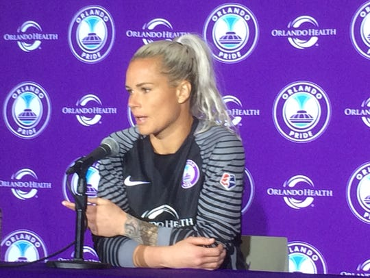 Orlando goalkeeper Ashlyn Harris talks to the media