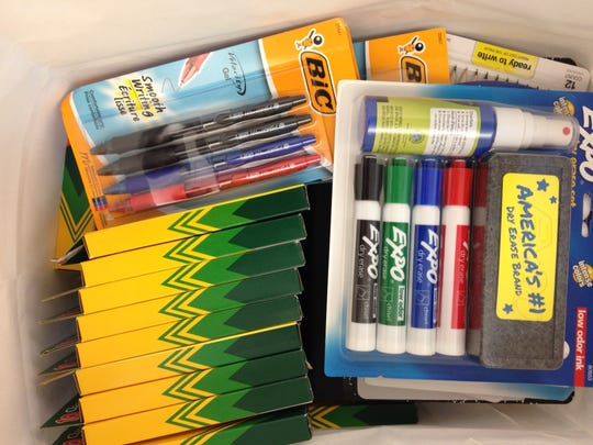 Dry erase markers, pens and crayons are some common school supply list items.