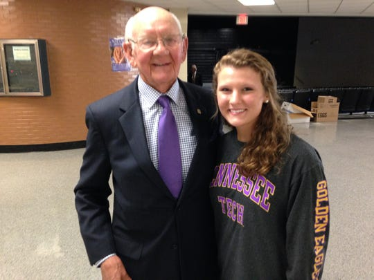 Tom Hendrix (right) visits with Olivia Mitchell, a