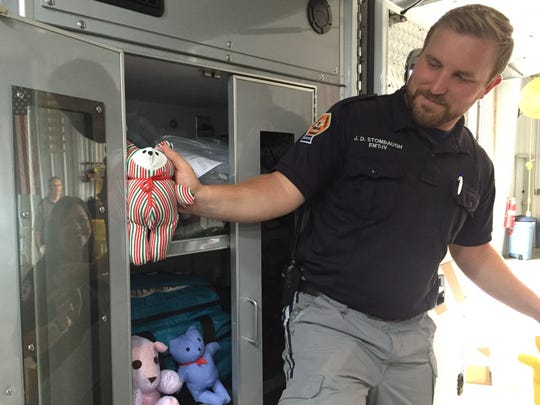 Rutherford County EMS worker J.D. Strombaugh puts up