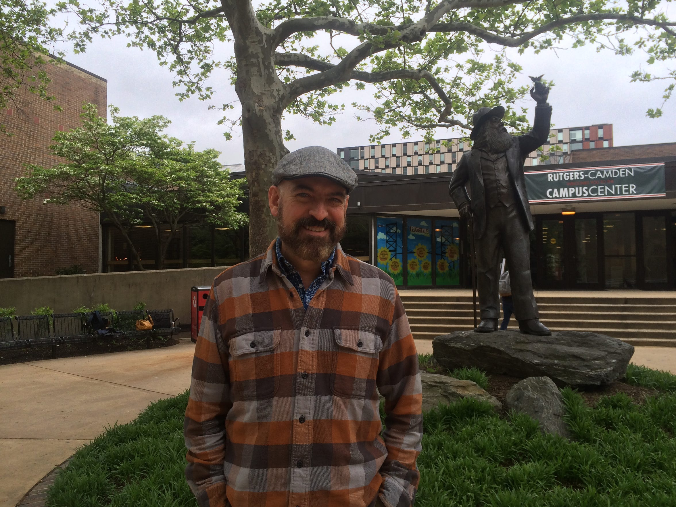 Paul Lisicky, shown here outside the Student Center at Rutgers-Camden, was recently named a 2016 Guggenheim Fellow.