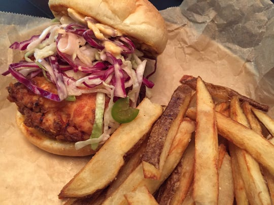 The fried chicken sandwich is made with chicken breast, a sweet pickle slaw and a spicy aioli.