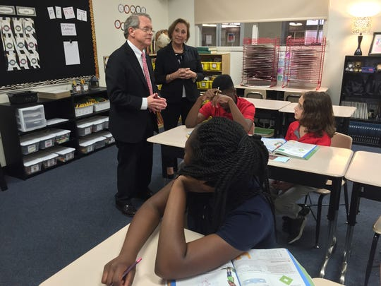 Ohio Attorney General Mike DeWine speaks with a class of fifth graders Wednesday during a visit to the Richland School of Academic Arts.