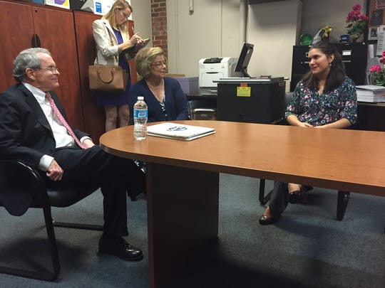 Superintendent Sandra Sutherland looks on as teacher Chesley Talissé shares a story with Ohio Attorney General Mike DeWine during his visit to the Richland School of Academic Arts.