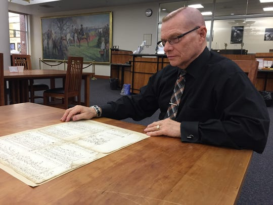 Stephen M. Marz, director of the Delaware Public Archives, with the last-known accounting of slave ownership in Sussex County.