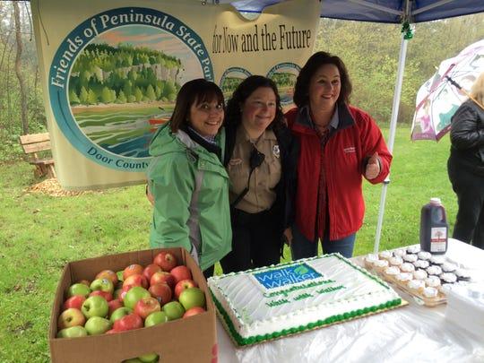 First lady Tonette Walker, Peninsula Park Superintendent Kelli Bruns and Department of Tourism Secretary Stephanie Klett celebrate the 50th Walk with Walker event.