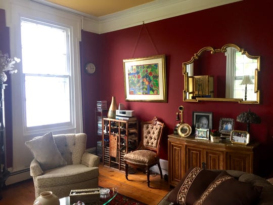 The Browns' living room features antique furniture from Heather's grandmother that has been reupholstered.