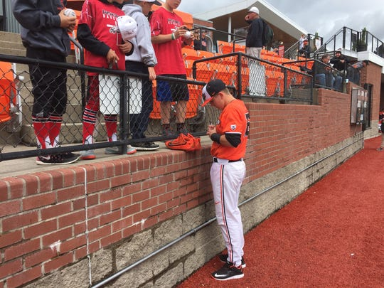 Oregon State catcher Zak Taylor signs autographs for fans before Sunday's game at Goss Stadium.