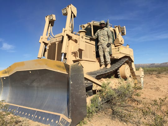 Spc. Malcolm Patterson, from Detroit, used a specially quipped Army bulldozer to dig fighting positions during the Network Integration Evaluation.