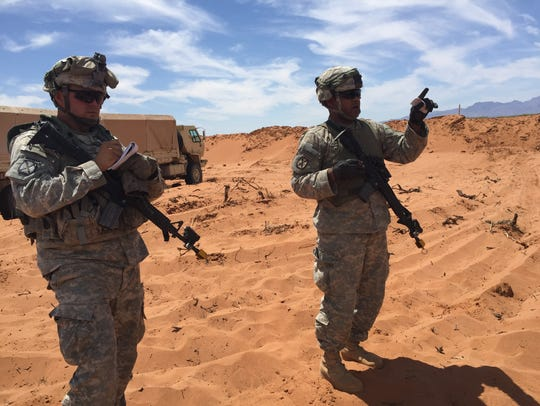 Sgt. Tyrone Martin, right, discusses a convoy exercise