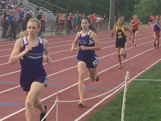 Mount Gilead senior Jenna Shipman, left, leads teammate Darcy Picker and Northmor's Maria Lee to the finish of the Blue Division girls 800-meter run Thursday at Mount Gilead during the Mid Ohio Athletic Conference Track Championships.