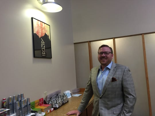 Rob Weakley CEO of Altai Brands stands in front of some of the marijuana-infused sweets that the company manufactures.