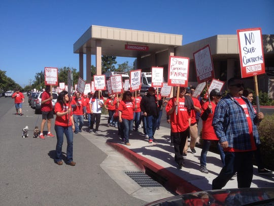 SVMH workers on strike circle the hospital Tuesday morning in a demonstration over stalled contract talks.