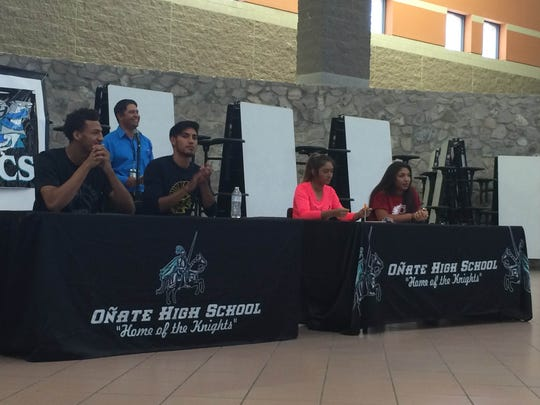 Front left to right, Onate's Johnny McCants, Rudy Reyes,