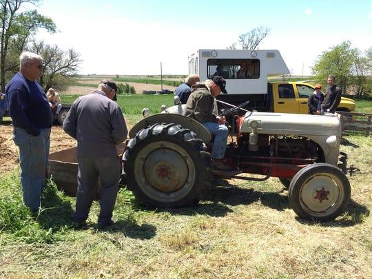 My dad, Lloyd Munson, sits on his prized Ford 8N tractor