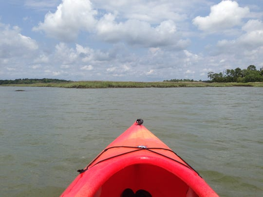 Amber Solnick shares the view from her kayak during a paddle along salt marsh oyster beds in Lowcountry, Sout Carolina.