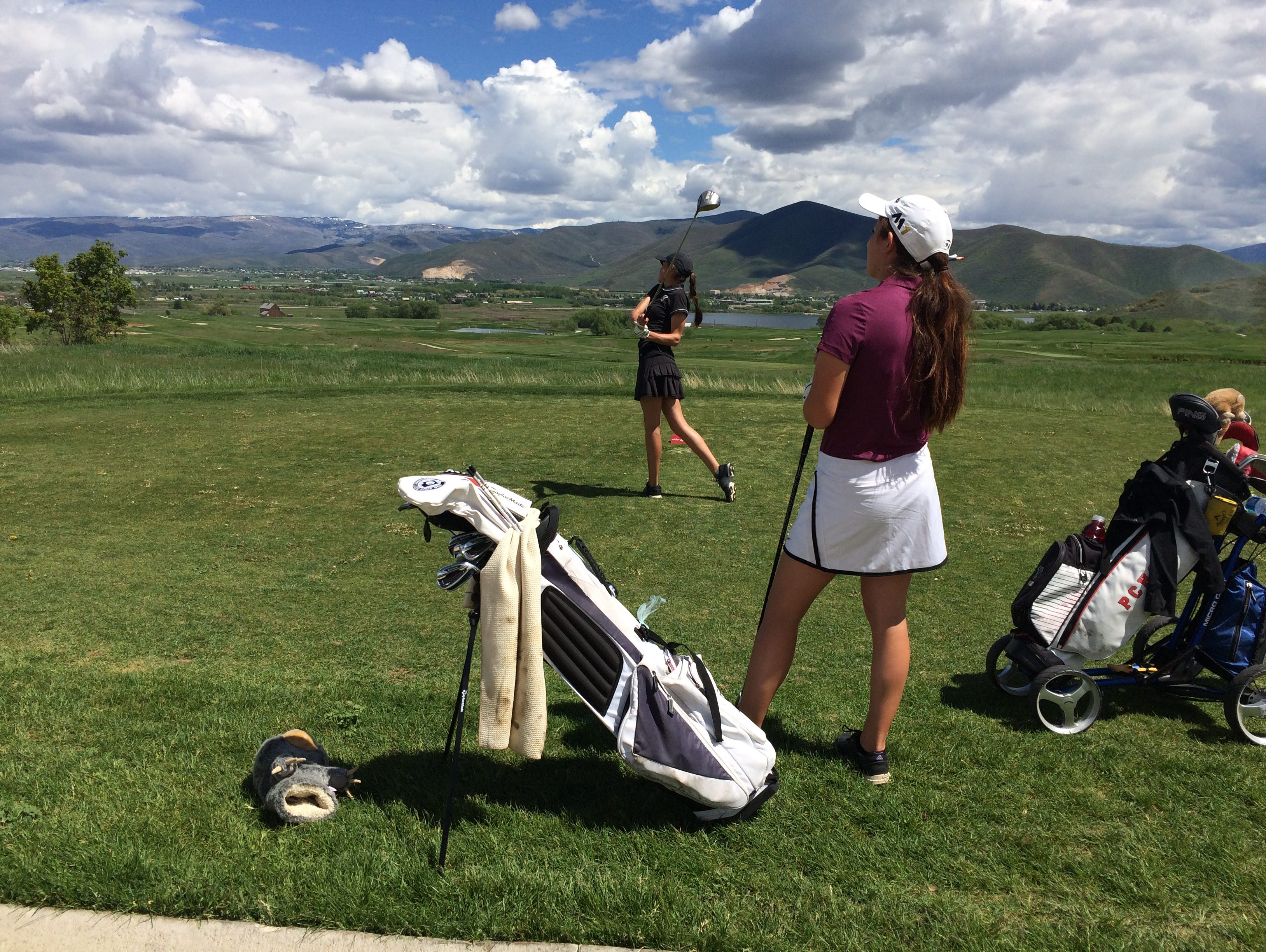 Desert Hills' Kyla Smith looks on as Park City's Saylor Rabe hits off the tees. Smith, along with Dixie's Gracie Richens carded the top score of the day with a 2-over par 74 at Soldier Hollow on Wednesday.